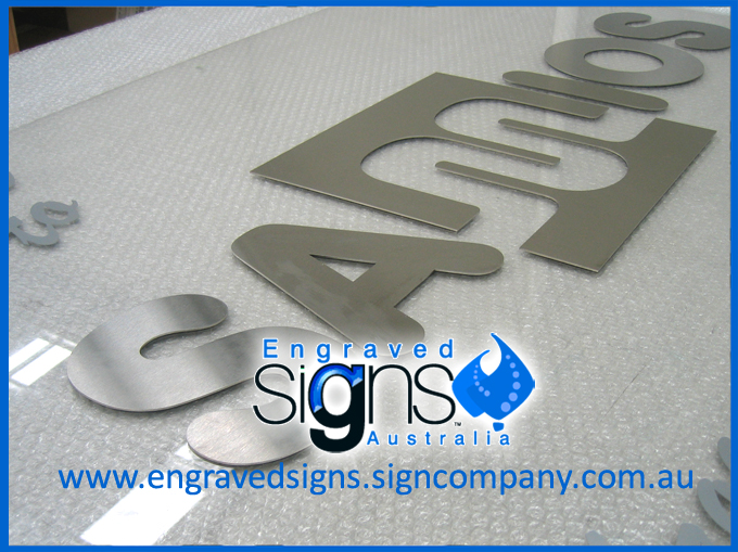 Metal letters cut out for a large building sign wall